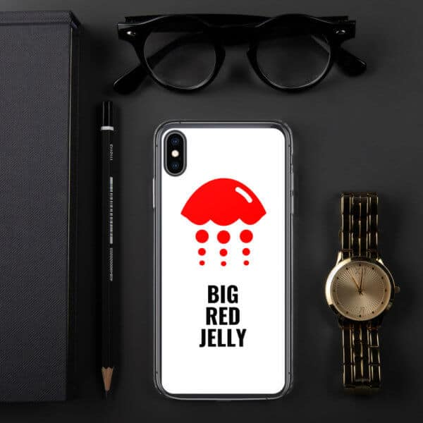 Big Red Jelly Iphone Case surrounded by watch, glasses, and pen