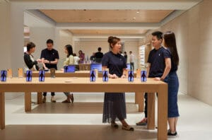People shopping in Apple store in Japan